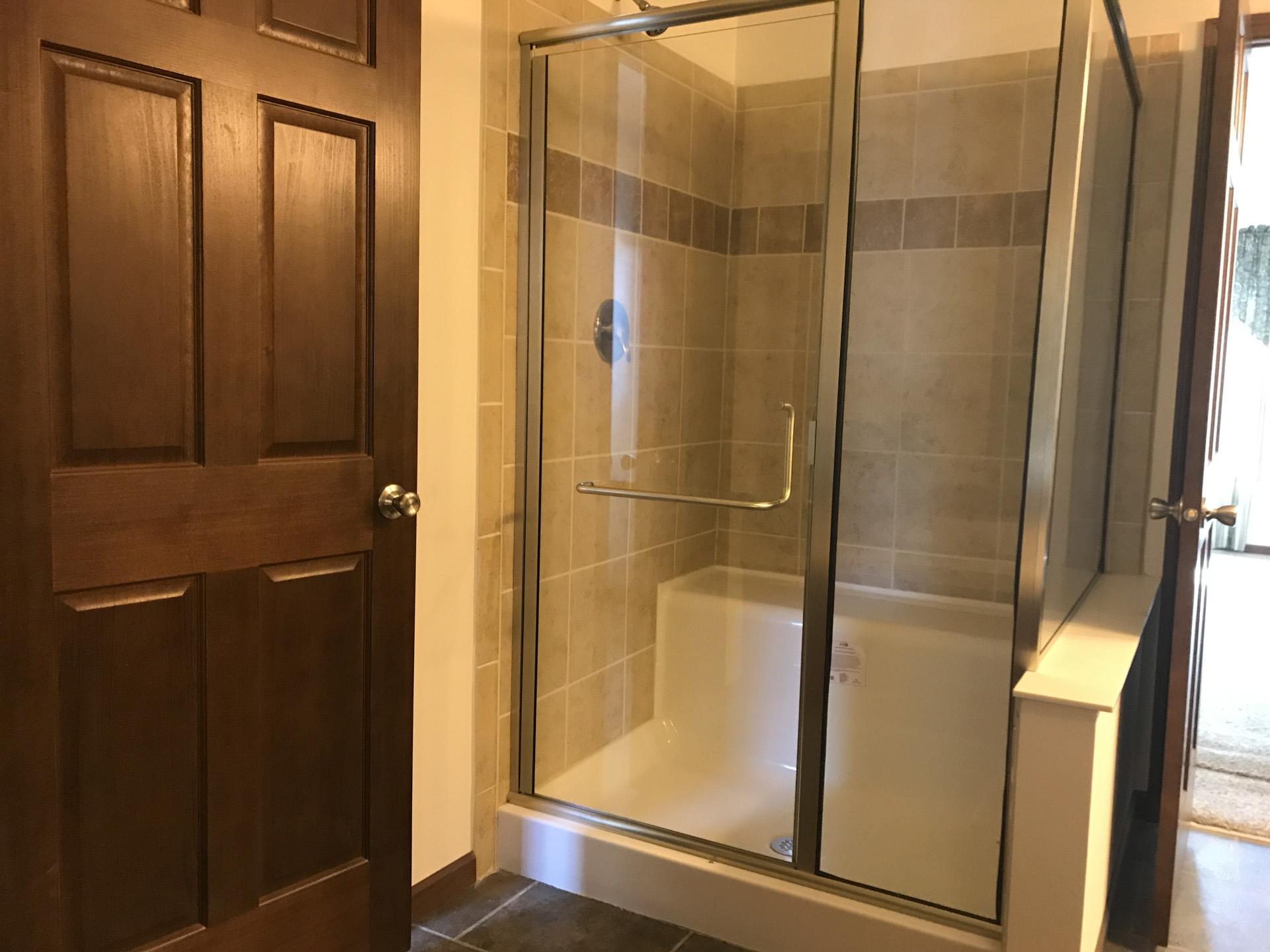 Pinewood walk-in glass shower - D&W Homes